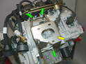 The Carrera 996 engine incorporates a completely different method of mounting and securing the engine to the chassis (yellow arrow).