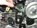 Disconnect the coolant hose from the connection on the front of the engine (yellow arrow).