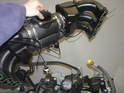 When installing a Carrera 996 engine into the Boxster, you typically use the 996 intake manifold.