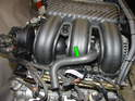 Shown here is the auxiliary air 'S' hose installed along with the intake manifold.