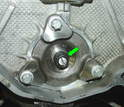 Using a screwdriver to hold the center bolt in place, tighten down the 12 point nut to to 24 ft-lbs maximum.