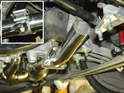 The crossover pipes are attached to the ends of the catalytic converter / header assembly and joined with a clamp (inset).
