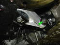 Remove the 16mm bolt securing the lower passenger side mount to the engine (green arrow).