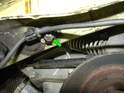 Remove the E12 Torx bolt underneath the passenger side engine mount.