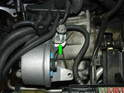 There is also a bracket for the clutch slave cylinder feed hose that is secured by one of the transmission mount bolts (green arrow).
