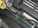 (R53 Cooper S) The other coolant bleeder screw is located on the upper radiator hose.
