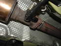 Next, remove the two 15mm nuts securing the rear exhaust to the catalytic converter.