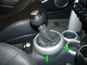 Next, take a small screwdriver and pry the shift boot cover up and off the center console.
