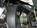 Shown here is the plastic pivot bolt coming out the other side of the clutch pedal arm.