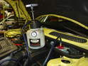 With the clutch master cylinder re-installed, attach a power bleeder to the brake reservoir and pressurize the system.