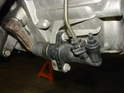 Remove the splash shield under the front of the engine and locate the clutch slave cylinder.