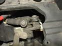 Remove the air filter assembly to access the upper shift cable connection to the transmission.