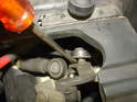 Use two screwdrivers to pry the spherical ball joints off the connection points at the linkage.
