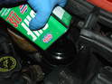 With the new pump installed, open the fluid reservoir and fill it up with CHF-11S power steering fluid only.