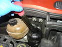 The first step is to remove as much power steering fluid as you can from the reservoir.