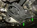 Slide underneath the car and remove the two nuts holding the power steering fan in place (green arrows).