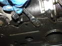Remove the 13mm nut on the underside of the front subframe.