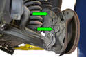 Illustrated here are the other 19mm bolt and nut (green arrows) that need to be removed from the front of the steering knuckle.
