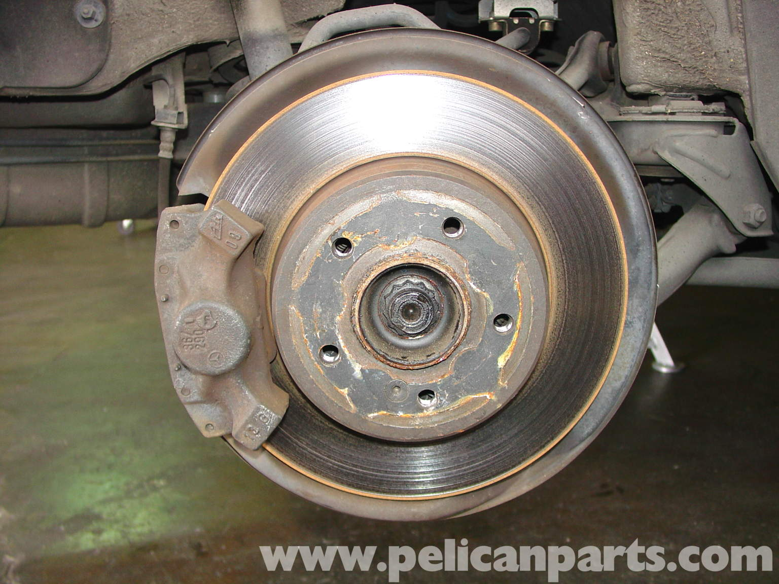 Mercedes benz w210 rear brake pad disc replacement 1996 for Mercedes benz brake calipers