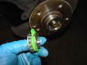 Pack the front wheel bearing with the high temp grease like you did with the rear bearing.