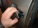 Now carefully pull the IR sensor out of the door handle from the outside.