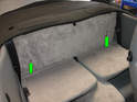 10:: Access the manual over-ride for the top requires removal of the panel directly behind the upper rear seats.