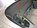 12:: To manually open or close the top, you'll first need to use the tool to open the side flaps on the car (green arrow).